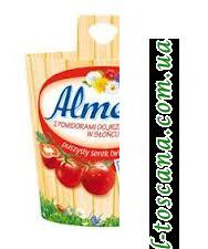 Сыр Almette z pomidorami dojrzewającymi w słońcu